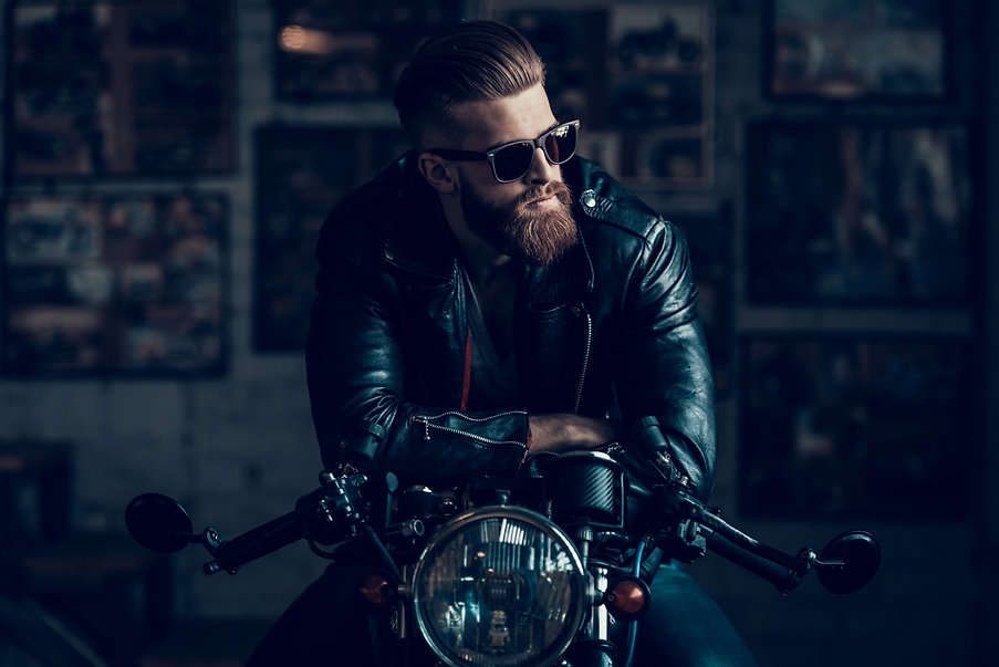 Young Bearded Biker Sitting on Motorcycl