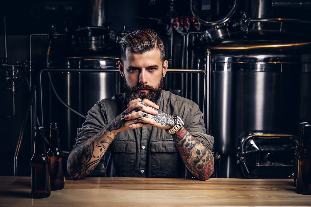 Portrait of a pensive tattooed hipster m