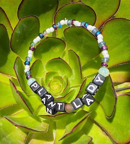 """""""Plant Lady"""" Beaded Bracelet (Black Lettering)"""