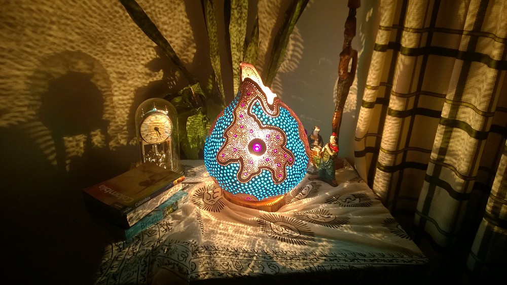 Not only by its colors but with its unusual shape, this gourd lamp design is something else.