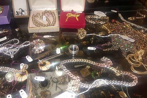 Hundreds of pieces of silver, gold, turquoise, and costume jewelry.