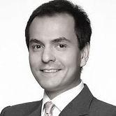 PAOLO SBUTTONI Partner, Baker McKenzie