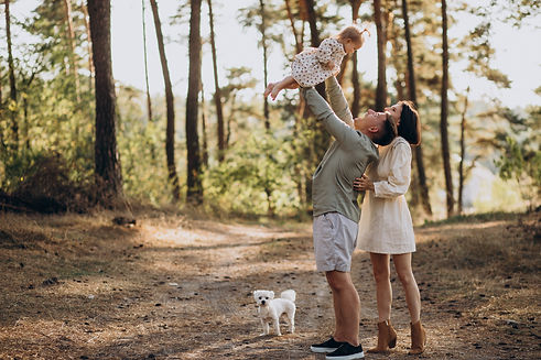young-family-with-cute-little-daughter-walking-forest-sunset.jpg