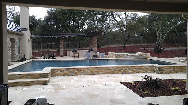 Partially raised pool for seating around the pool.