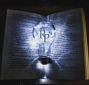 artistic committee lightbulb and book.png