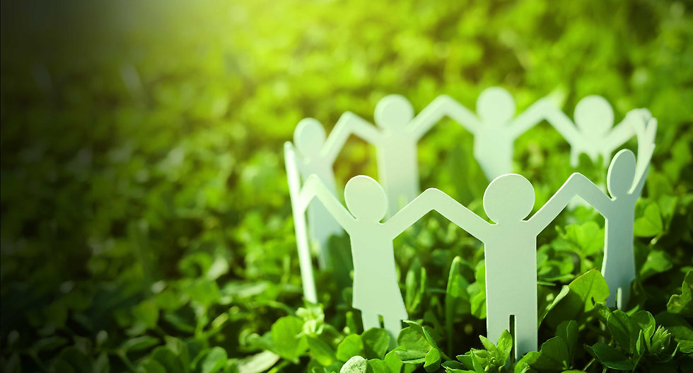 KPM Power famliy represented by paper cut little figures holding arms on a green grass environment