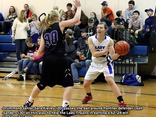 Trojan teams easily rout visiting Panthers