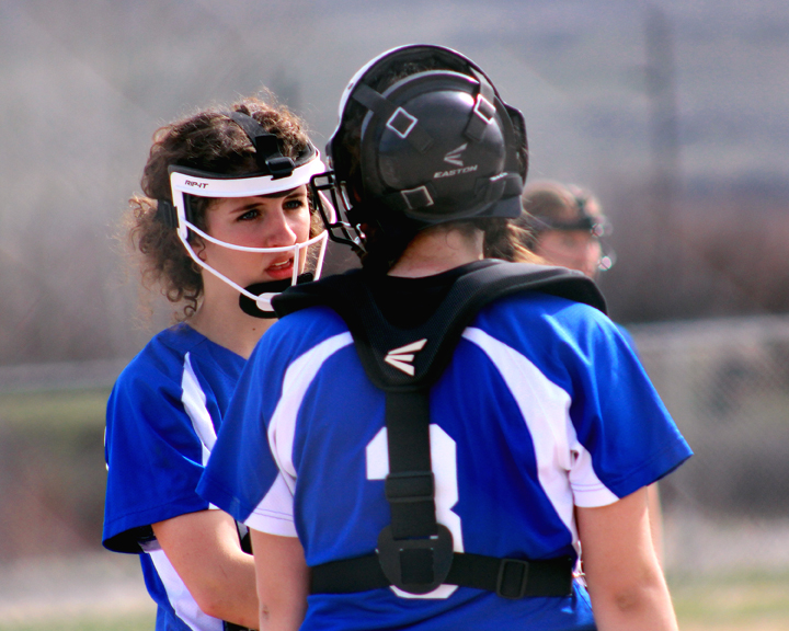 Drummond pitcher Makenzie Adler and catcher Kristen Piippo discuss tactics. (file photo)