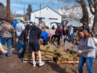 Community helps fill sand bags, clear culvert in Drummond