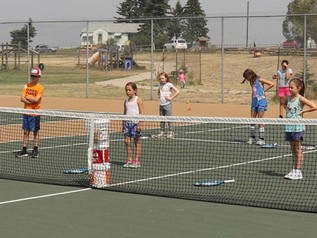 Campers get into the swing of tennis