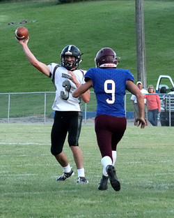 Titan QB Kade Cutler (3) airs on out on this play. He finished the night with three scoring passes.