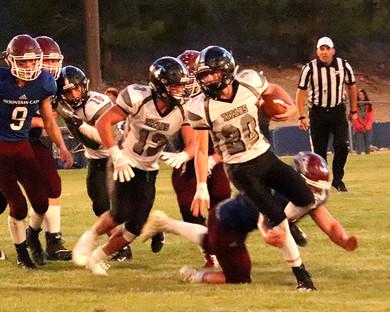 Titan running back Leyton Wagner (20) eludes a tackler.