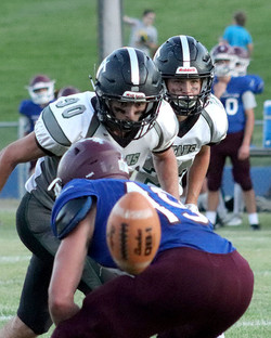 Titan defenders Wyatt Rigby (90) and Avery Metesh (23) just before pursuing the ball Friday night.