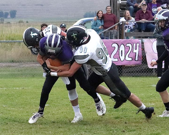 Titan linemen Wyatt Rigby (90) and Tucker Weaver (32) combine to sack Viking QB Coyle Nagy/