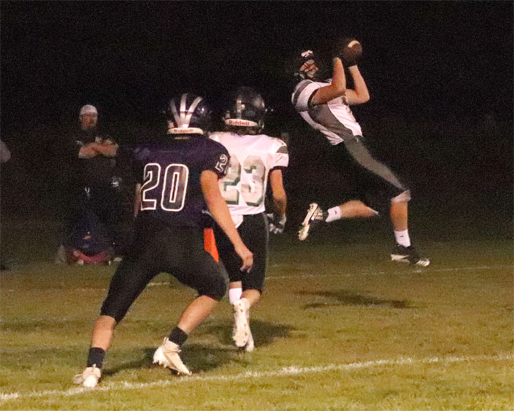 Andrew Tallon (2) catches a two-point conversion pass Friday night in Charlo.