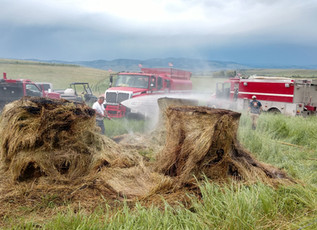 Lightning strikes sets hay bales ablaze near Hall