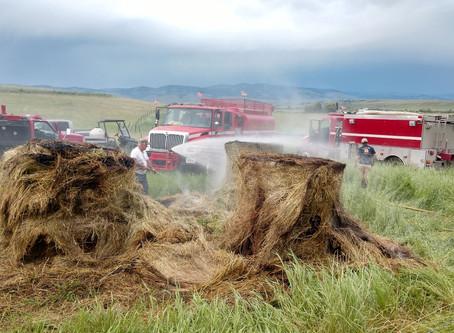 Lightning strikes sets hay bales ablaze near Hall