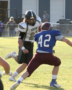 Flint Creek's Conley Wagner (21) takes on a Cats defender on this play.
