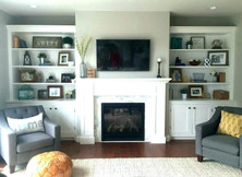 built-in-shelves-around-tv-and-fireplace