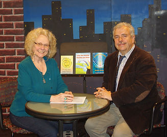 Ted Mahr, host of Out of This World TV interviewing Carolyn White