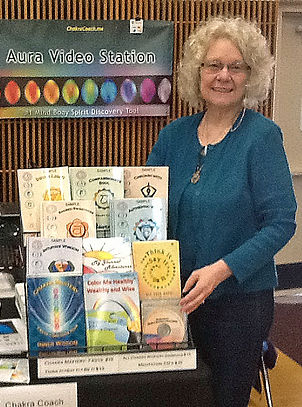 Carolyn White PhD pictured with her books