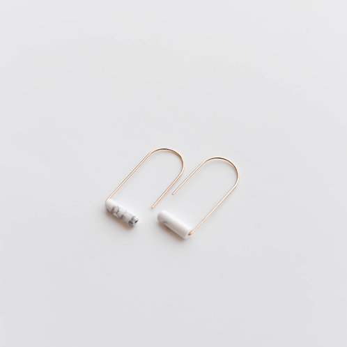 Semi-oval minimalistic earrings with marble howlith