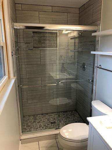 sliding shower door, shower enclosure, frameless shower, chrome shower door, towel bar shower door, baltimore showers, frederick showers, rockville shower doors, maryland shower doors.