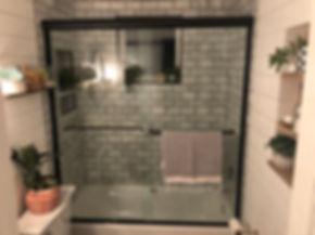 frameless sliding shower, black hardware shower, century shower doors, clear glass, rustic bathroom, pintrest bathroom, 3/8 glass, half inch glass, black shower, bathtub