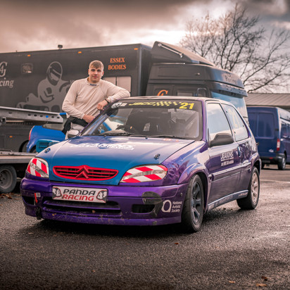 Citroen Saxo Blue and Purple with driver
