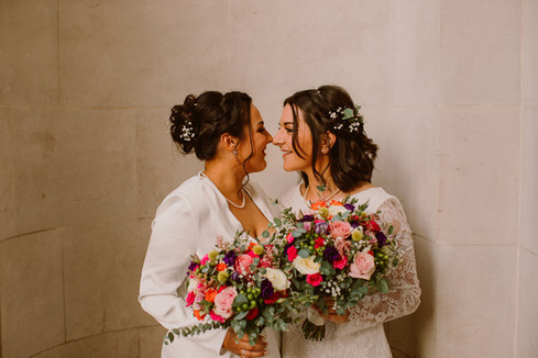 Two brides and their colourful bouquets