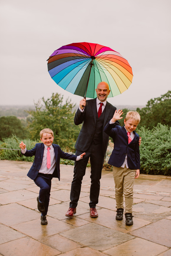 Father and son dancing in the rain