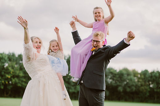 a wedding party celebrate their fun outdoor wedding in Bristol during the summer