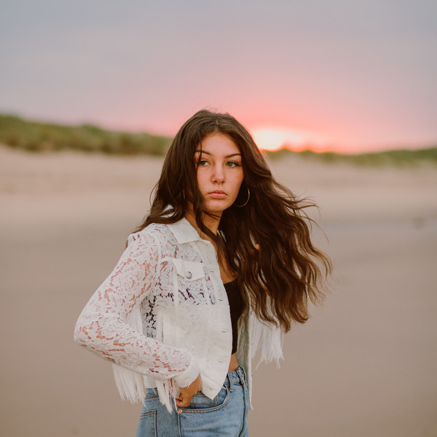 teenager photographed on the beach during sunset