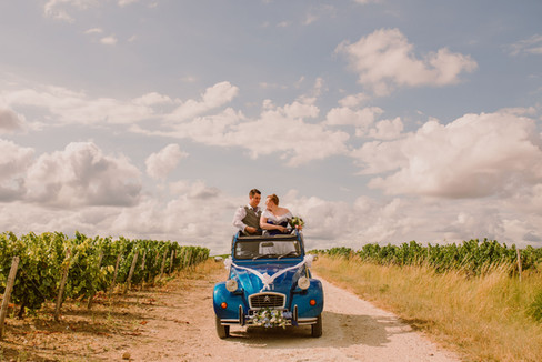 Wedding Couple in their car in French Vineyard