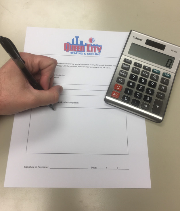 Hand writing estimate on Queen City Heating & Cooling estimation form calculator to the right of form