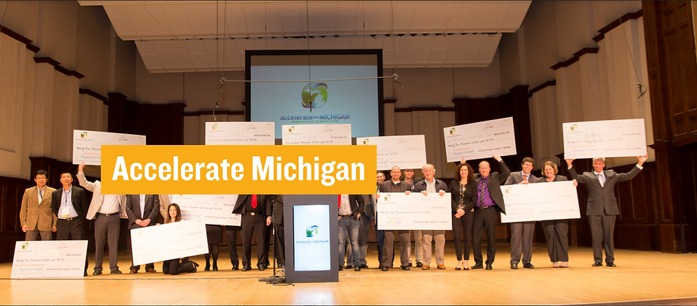 Accelerate Michigan startup pitch competition winners on stage