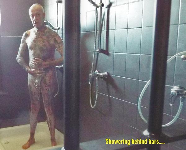 #A9636AN showering behind bars.JPG