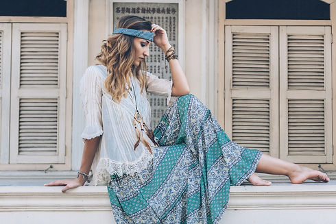 Fashion girl wearing bohemian clothing posing in the old city street. Boho chic fashion style..jpg