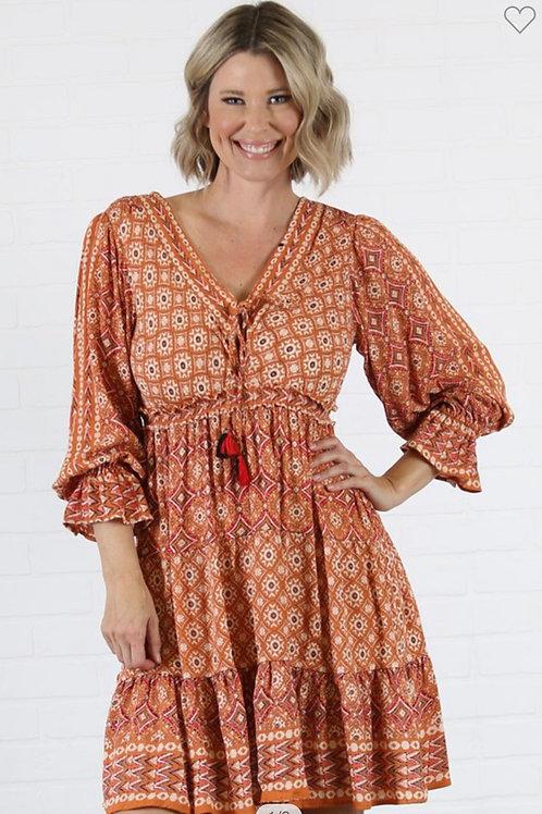 Rust v neck with tassels ruffle dress