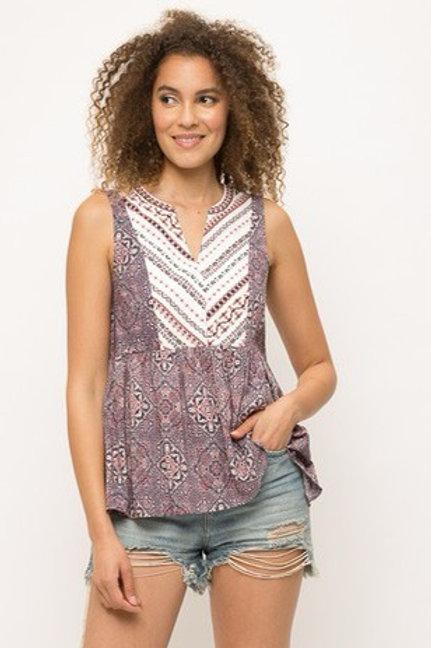 Purple floral ruffle bottom blouse