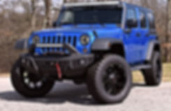 Blue Rocky Ridge Custom Lifted Jeep Wrangler with Summit Package