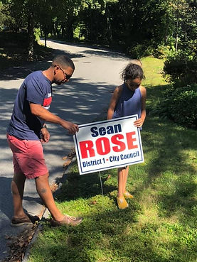 Sean putting in sign with Charlotte.jpg