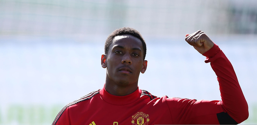 Andy Cole has told Anthony Martial he needs to improve. [Getty]