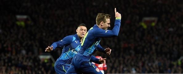 Monreal celebrates his goal at Old Trafford.