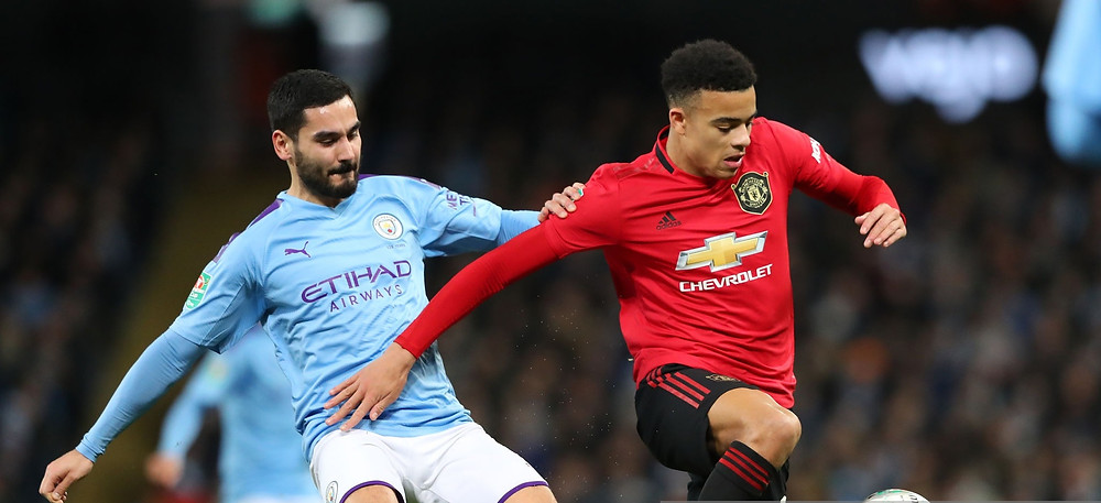 Greenwood [R] vying for the ball with Gundogan. [Getty]