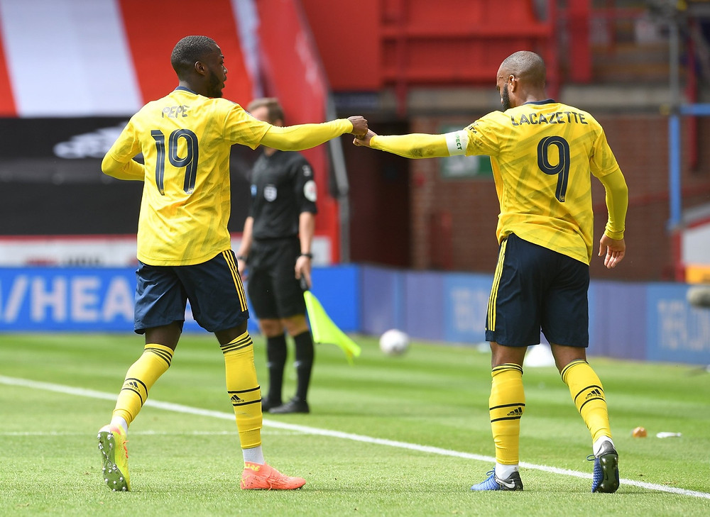 Pepe (L) has scored eight goals and registered eight assists this season. (Twitter/@Arsenal)