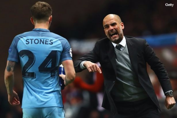 Guardiola gives instructions to Stones.
