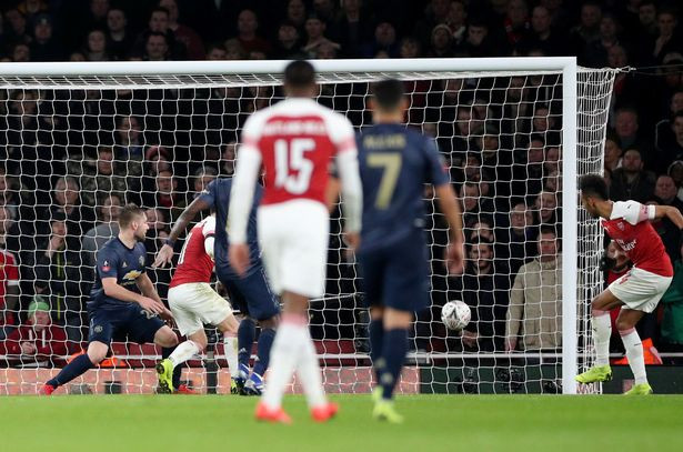 Aubameyang pulled one back before the break (Image: REUTERS)