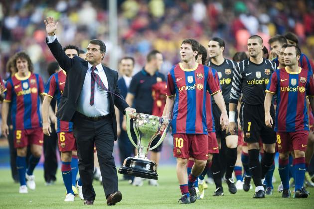 Joan Laporta (left) and Lionel Messi with the LA Liga title. [Getty]