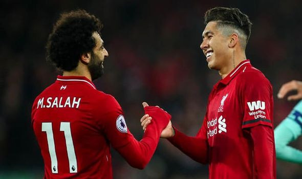 Mohamed Salah and Roberto Firmino after Arsenal win.